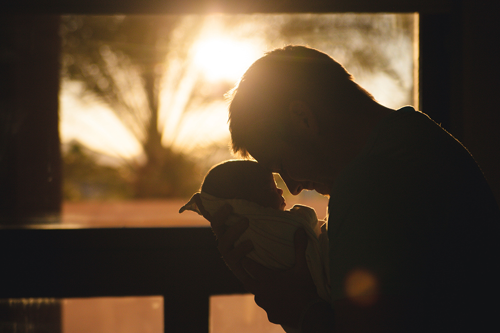 image of father and child thematically depicting parentage or paternity actions